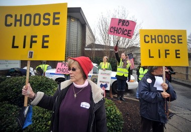 "Pro-life and pro-choice activists gather outside Alabama Women's Center for Reproductive Alternatives during a recent ""40 Days of Life"" prayer vigil. (Sarah Cole 
