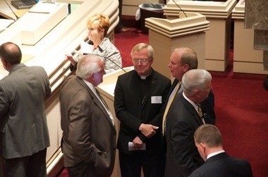 Father James Henderson meets with lawmakers at the Alabama State House before passage of the Women's Health and Safety Act on Tuesday. (Courtesy James Henderson)