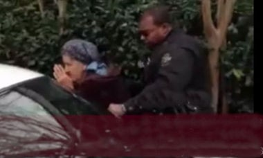 This screen capture from a YouTube video shows anti-abortion activist Joyce Fecteau being arrested outside Alabama Women's Center for Reproductive Alternatives on Jan. 9.
