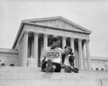 Outside the U.S. Supreme Court building, Nettie Hunt explains to her daughter Nickie the meaning of the court's Brown vs. Board of Education ruling. (Bettman/Corbis photo courtesy of the Library of Congress.)