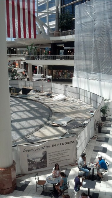 Construction work at Hoover's Riverchase Galleria is expected to be complete in August. The redevelopment includes new retailers and updates throughout the property. Above, shoppers eat at the mall's food court, where the elevators are being demolished and the carousel has been removed for a refurbishment. (Dawn Kent Azok/dazok@al.com)