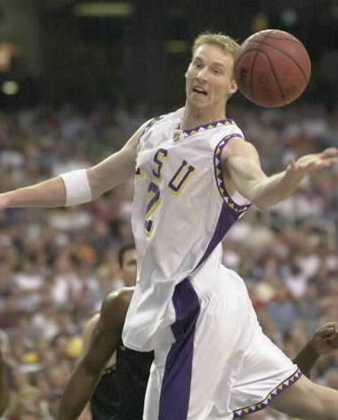 LSU's Brian Beshara reaches for a rebound in a March 2000 SEC tournament basketball game in Atlanta. (File/The Birmingham News)
