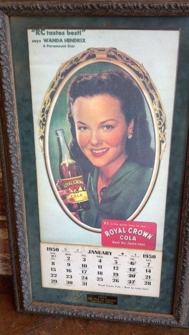 "A calendar, featuring ""Paramount Star"" Wanda Hendrix drinking R.C. Cola, is from 1950, the year when the Sheraton Apartments opened. O'Henry's Coffees opened a location in Birmingham's Highland Park neighborhood on Thursday, Dec. 5, 2013. (Madison Underwood 