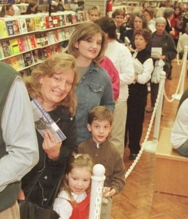 People wait in line to get President Jimmy Carter to autograph one of his books at the Books-A-Million in the Hoover Commons shopping center in Hoover, Ala., in January 2001. (Steve Barnette/The Birmingham News)