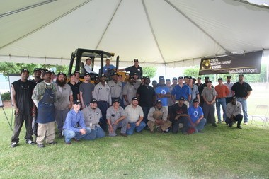 Employees of O'Neal Manufacturing Services gather around a Caterpillar bulldozer on display outside the company's Birmingham office today. O'Neal Industries Chairman Craft O'Neal sits in the cab. (Special to AL.com/O'Neal Industries)