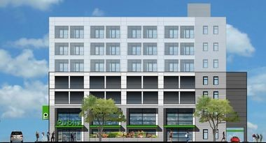 The future downtown Publix as it will appear facing 20th Street. The project includes a parking deck above the grocery store and as many as 70 apartments on three stories above the parking deck. (Cohen Carnaggio Reynolds)