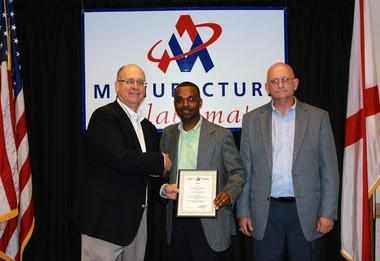 Shawn Blenis, left, chairman of Manufacture Alabama, presents Maurice Ware and Barton Turner of BASF's McIntosh, Ala., site with a safety award at the annual Manufacture Alabama Safety/Human Resources/Health Conference. (Courtesy BASF)