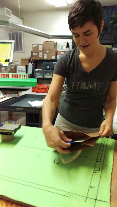 Rachel Lackey works on a screen printing project at Green Pea Press.