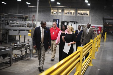 Bessemer Mayor Kenneth Gulley takes a tour of the facility with Milo's Tea CEO Tricia Wallwork.