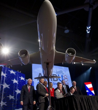 Airbus and Alabama officials celebrate at the company's official announcement of its Mobile plant in July. The Mobile City Council is now responsible for approving contracts with the state to improve public roads within the Brookley Aeroplex complex. (File photo)
