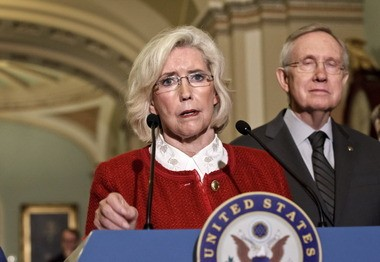 Lilly Ledbetter is pictured here with Senate Majority Leader Harry Reid of Nevada at a news conference on Capitol Hill last June. (AP photo)