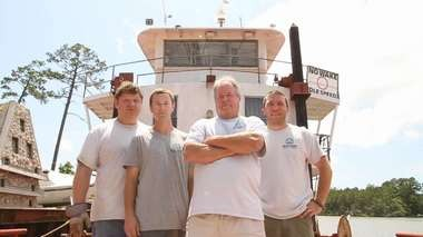 "The cast of ""Reef Wranglers:"" from left are Roger Strick, Stewart Walter, David Walter and Justin Stoufflet. (Courtesy of the Weather Channel)"