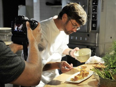 Birmingham chef Chris Hastings of Hot and Hot Fish Club prepares a seafood dish for an Alabama Gulf Seafood Commission commercial filmed at his restaurant last year. (Joe Songer/AL.com)
