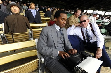 """Holland, in character as Wendell Smith, sits in the Rickwood Field stands with movie extra Jim DeGraw during the """"42"""" filming last May. (Joe Songer/jsonger@al.com)"""