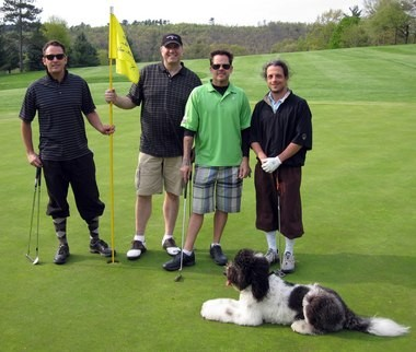 Goldendoodle Lucy travels with country singer Gary Allan, second from right. Here, they hit the links with friends in Jim Thorpe, Pa. (Adventures with Lucy Facebook page)