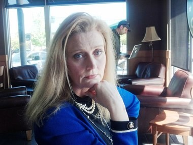 """Huntsville attorney turned author Daco Auffenorde strikes a serious pose while discussing her debut romantic suspense novel """"The Libra Affair"""" in a Huntsville coffee shop on Tuesday, May 7, 2013. (Lee Roop/lroop@al.com)"""