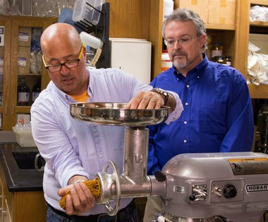 At UAB, Zimmern makes pasta-like feed that biology professor Steve Watts, right, uses to feed the sea urchins he is breeding for potential commercial use. (Photo courtesy of the Travel Channel)