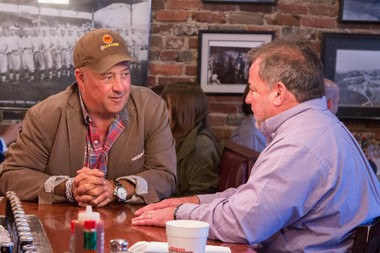Zimmern visits with Jim 'N Nick's Bar-B-Q co-founder Nick Pihakis, who has built a pig-processing plant to help independent hog farmers compete with larger pork producers. (Photo courtesy of the Travel Channel)