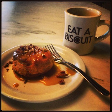 The signature Alabama Biscuit is topped with toasted pecans and a caramel-like sauce. (Bob Carlton/bcarlton@al.com)