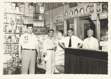 Paul A. Spina, far left, and his father, Sam Spina, second from right, are pictured here at the original Sam Spina Importing Co. on Birmingham's Morris Avenue during the 1930s. (Photo courtesy of Tommy Spina)