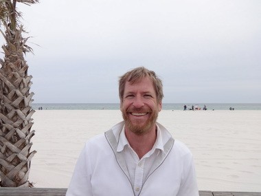 Not the worst workplace in the world: Sean O'Connell, director of the Hangout Music Fest, is shown at the festival site. (Lawrence Specker/lspecker@al.com)