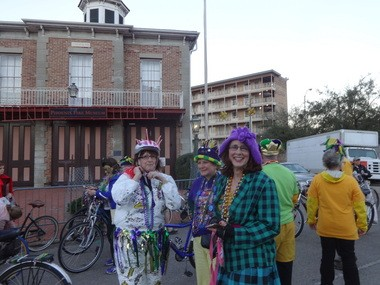 Rosi Whaley, in white, and Pam Hockey, with purple bonnet, prepare to ride with a Mobilians on Bikes group in the Order of Venus parade on Monday, Feb. 9, 2015. (Lawrence Specker/lspecker@al.com)