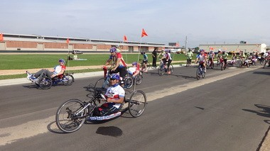 Cyclists roll out from the Mobile Aeroplex at the start of the AeroFest Independence Ride's shorter routes. (Lawrence Specker/lspecker@al.com)