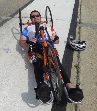 Trey LaFitte of Laurel, Miss., smiles after powering his handcycle from Bayou La Batre to Mobile in the AeroFest Independence Ride on March 21, 2015. (Lawrence Specker/lspecker@al.com)
