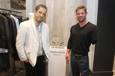 Alabama's Noah Galloway appears in a new ad campaign for Mankind, a fragrance by Kenneth Cole. Designer Cole, left, posed with Galloway in 2014. (PRNewsFoto/MANKIND Kenneth Cole)