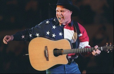 Garth Brooks in 1996, the year he last performed in Birmingham. This image comes from the first of five shows Brooks played at The Omni in Atlanta, on Wednesday, March 13, 1996. It marked the opening of his tour that year. (AP Photo/Atlanta Journal Constitution, Rich Mahan)