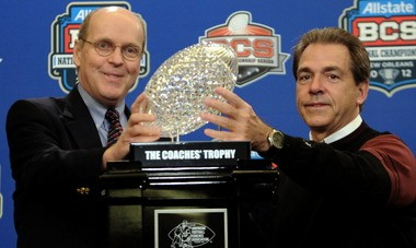 Bill Hancock, who was executive director of college football's Bowl Championship Series, poses with Alabama head Coach Nick Saban and the Coaches' Trophy during a press conference after Alabama won the BCS National Championship in New Orleans, on Jan. 9, 2012. (The Birmingham News/Mark Almond)
