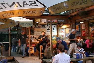 The Bay Area Songwriters Association regularly performs at Old 27 Grill in Fairhope. Alan Hartzell, ringleader of the group, can be seen standing to the left of the performer. (Lawrence Specker/lspecker@al.com)