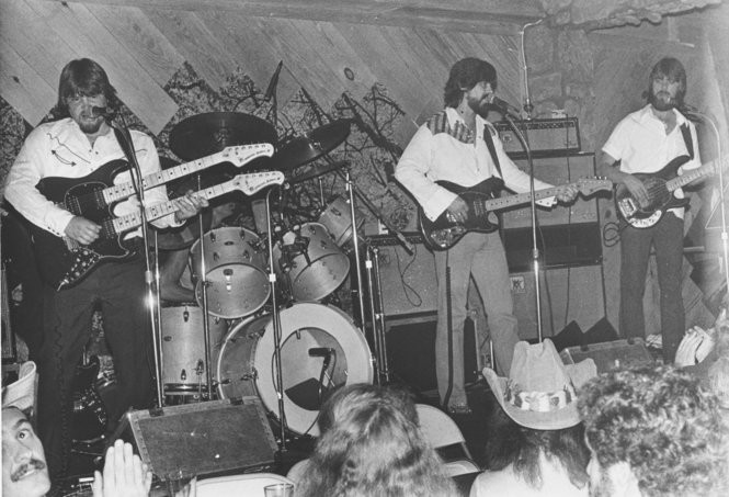 Alabama performs. On the far left, Jeff Cook is playing a double-neck guitar. (File photo)