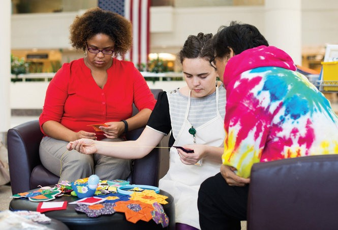 More than 100 volunteers worked with Lillis Taylor, center, to create two quilts celebrating the fifth anniversary of the Women and Infants Center at the University of Alabama at Birmingham. (UAB photo/Steve Wood)