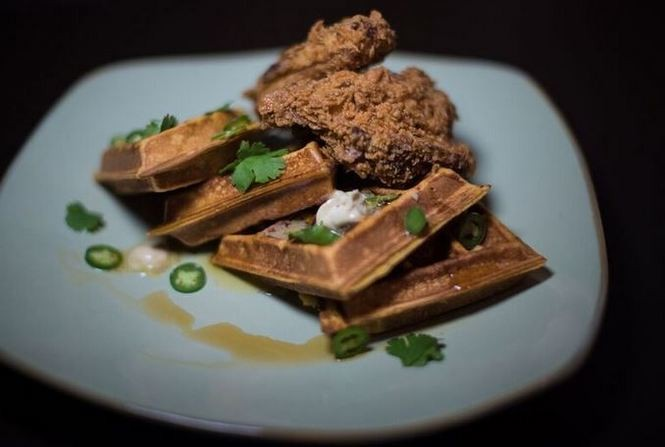 The menu at Sky Castle Gastro Lounge includes chicken and waffles, with sweet tea-brined chicken thighs and sweet potato waffles. (Photo by Andi Rice/www.instagram.com/riceandi)