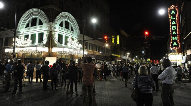 A crowd gathered outside the Lyric Theatre for the lighting of a new marquee in fall 2013. (Joe Songer | jsonger@al.com)