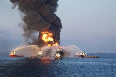 Firefighting boats attempt to get control of a fire aboard the Deepwater Horizon drilling platform in the Gulf of Mexico in 2010. (Dispatches from the Gulf image courtesy of GulfQuest)