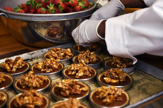 These chocolate-caramel nut tarts are on the dessert menu at Chez Fonfon. (Tamika Moore/tmoore@al.com)