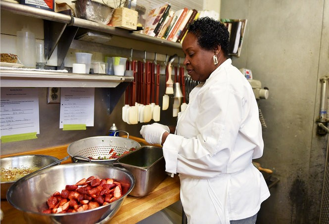 Dolester Miles slices strawberries that she will use to create a different strawberry dessert for each of Frank and Pardis Stitt's four restaurants. (Tamika Moore/tmoore@al.com)