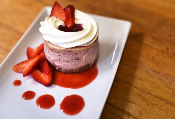 This strawberry cheesecake is on the dessert menu at Bottega Cafe. (Tamika Moore/tmoore@al.com)