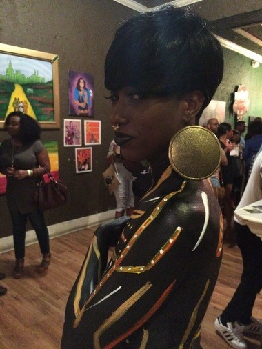 Dierdre Harris models body art created by Noelle Goodson at the Art of Perception gallery show in Mobile on Sunday, May 29, 2016.