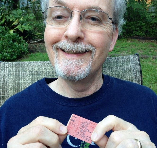 Pat Logan holds his ticket stub to the Rolling Stones' 1972 concert in Mobile. (Courtesy photo)