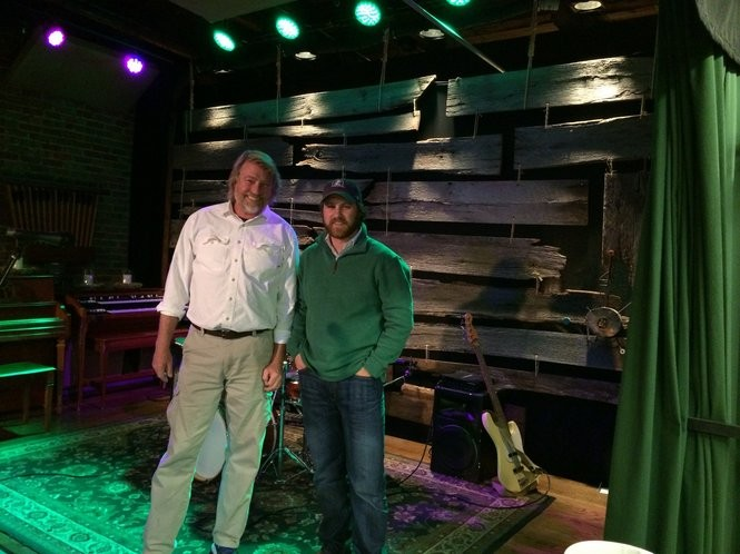 Danny Davis, left, and Todd Haller stand on the stage at Tangled String Studios. (Matt Wake/mwake@al.com)