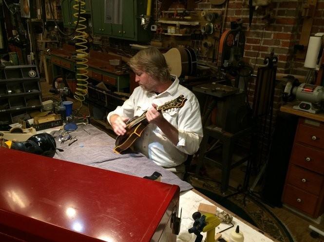 Huntsville luthier Danny Davis works on a mandolin at Tangled String Studios. (Matt Wake/mwake@al.com)