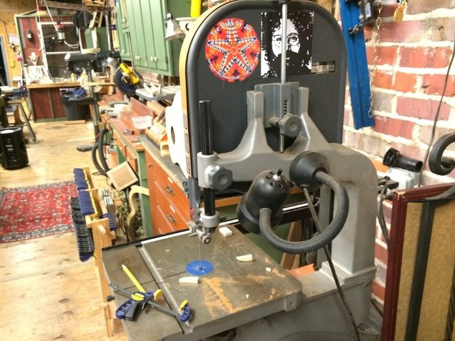 A band-saw in Tangled String Studios' guitar shop has been decorated with a Jerry Garcia sticker. (Matt Wake/mwake@al.com)