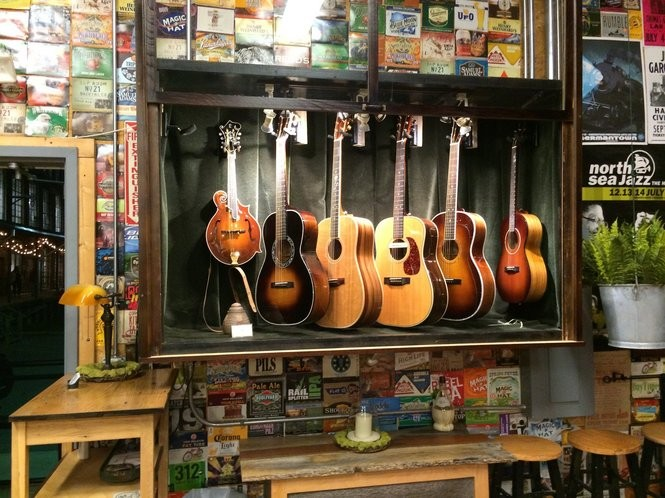 A row of Danny Davis Guitars at Tangled String Studios. (Matt Wake/mwake@al.com)