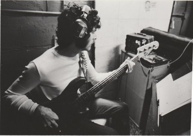 A vintage photo of David Hood recording at Muscle Shoals Sound. (Courtesy Muscle Shoals Music Foundation)