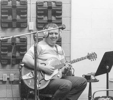 A vintage photo of Jimmy Johnson recording. (Courtesy Muscle Shoals Music Foundation)
