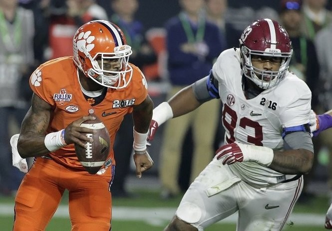 Clemson quarterback Deshaun Watson, left, tries to get away from Alabama's Jonathan Allen during the first half of the NCAA college football playoff championship game Monday, Jan. 11, 2016, in Glendale, Ariz. (AP Photo/Chris Carlson)