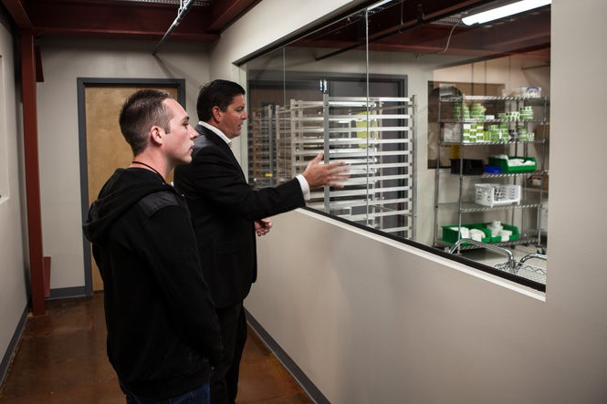 Dixie Brands co-founder Tripp Keber leads a tour of one a the company's facility in Denver. (Courtesy Dixie Brands)